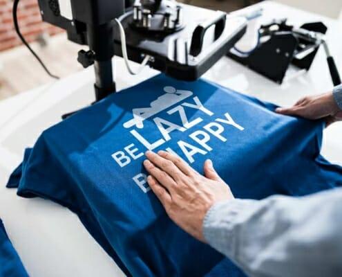 digital heat transfer printing blue t-shirt on table